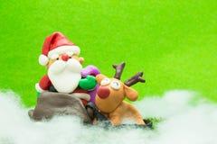 Papá Noel con el reno Imagenes de archivo