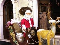 Papá Noel con el reno fotografía de archivo libre de regalías
