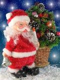 Papá Noel con la alarma fotos de archivo