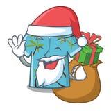 Papá Noel con la suspensión hawaiana de las camisas de la historieta del regalo detrás de la puerta ilustración del vector
