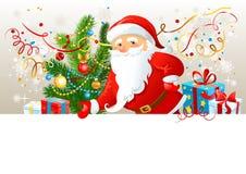 Papá Noel con la tarjeta en blanco Imágenes de archivo libres de regalías