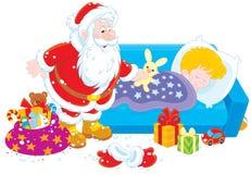 Papá Noel con los regalos para un niño Foto de archivo libre de regalías