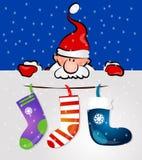 Papá Noel con los regalos y los calcetines Imagen de archivo libre de regalías