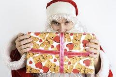 Papá Noel con un regalo Imagenes de archivo