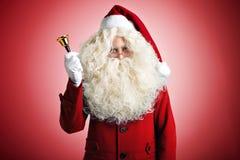 Papá Noel con una alarma Imágenes de archivo libres de regalías