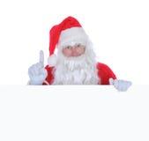 Papá Noel con una muestra en blanco Foto de archivo