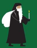 Papá Noel con una vela Imagen de archivo libre de regalías