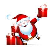 Papá Noel da los regalos Fotografía de archivo libre de regalías