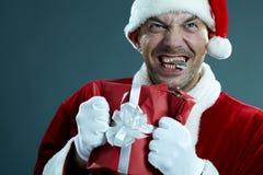 Papá Noel desequilibrado Imagenes de archivo