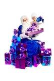 Papá Noel en azul con las porciones de presentes Fotografía de archivo libre de regalías