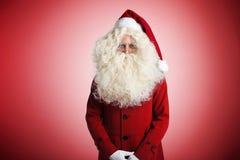 Papá Noel en fondo rojo Fotografía de archivo libre de regalías