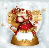 Papá Noel en snowglobe Fotos de archivo libres de regalías