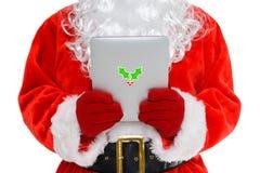 Papá Noel en su tableta foto de archivo