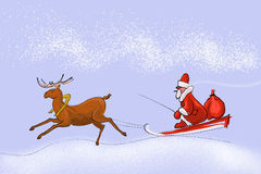 Papá Noel en un trineo Fotografía de archivo