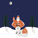 Papá Noel en una cabra Foto de archivo
