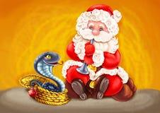 Papá Noel - encantador de serpiente. Fotos de archivo