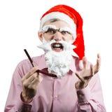 Papá Noel enojado con la maquinilla de afeitar Foto de archivo libre de regalías