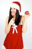 Papá Noel femenino con la bola de la Navidad Imagen de archivo libre de regalías