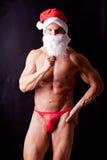 Papá Noel muscular Imagen de archivo libre de regalías