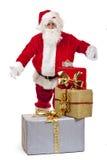 Papá Noel presenta los rectángulos de regalo de la Navidad Fotografía de archivo libre de regalías