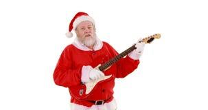 Papá Noel que canta una canción y que toca la guitarra metrajes