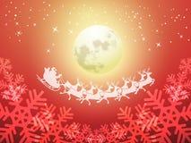 Papá Noel que conduce su trineo en una noche iluminada por la luna Imagen de archivo libre de regalías