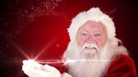 Papá Noel que hace un regalo mágico de la Navidad aparece metrajes