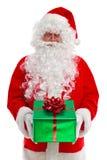 Papá Noel que le da un regalo Fotografía de archivo