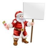 Papá Noel que lleva a cabo la brocha y la muestra Imágenes de archivo libres de regalías