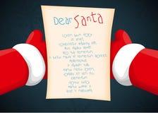 Papá Noel que lleva a cabo una letra Foto de archivo libre de regalías