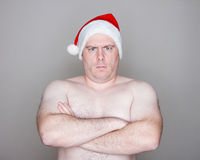 Papá Noel que mira la cámara Fotos de archivo