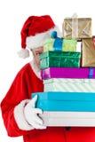 Papá Noel que oculta detrás de los regalos Fotografía de archivo