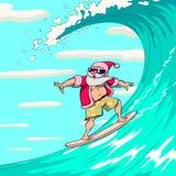 Papá Noel que practica surf Foto de archivo libre de regalías