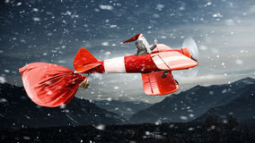 Papá Noel que se apresura hasta entrega los regalos Técnicas mixtas Imagenes de archivo