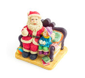 Papá Noel que se sienta con un niño Imagenes de archivo