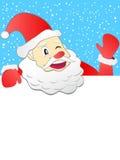 Papá Noel que se sostiene con el letrero Fotografía de archivo libre de regalías