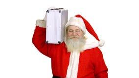 Papá Noel que sostiene la cartera aislada almacen de video