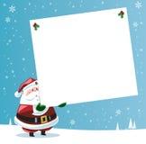 Papá Noel que sostiene la etiqueta grande del regalo Imagen de archivo