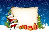 Papá Noel que sostiene un caramelo Foto de archivo