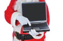 Papá Noel que sostiene un ordenador portátil Fotografía de archivo