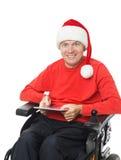 Papá Noel que sostiene una tableta digital Imagen de archivo