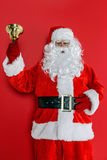 Papá Noel que suena su campana Foto de archivo libre de regalías