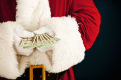 Papá Noel: Santa Holding Fanned Out Cash Fotografía de archivo libre de regalías