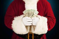 Papá Noel: Santa Holding Fanned Out Cash Fotografía de archivo