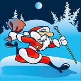 Papá Noel se apresura para arriba. Fotos de archivo libres de regalías