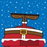 Papá Noel se pegó en la chimenea Imágenes de archivo libres de regalías