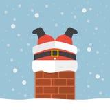Papá Noel se pegó en la chimenea Imagen de archivo