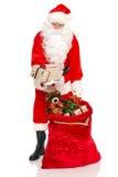 Papá Noel tiene un regalo para usted Imágenes de archivo libres de regalías