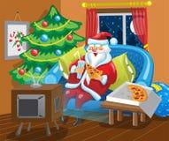 Papá Noel ve la TV Foto de archivo