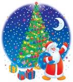 Papá Noel y árbol de navidad Fotos de archivo